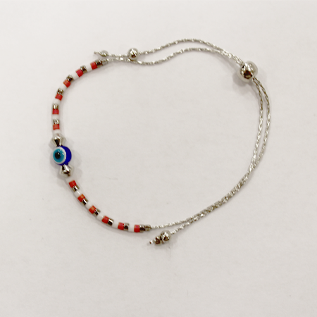 Red beaded bracelet against the Evil Eye