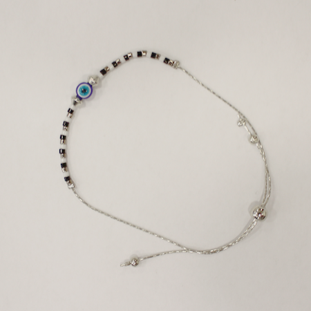 Black beaded bracelet against the Evil Eye